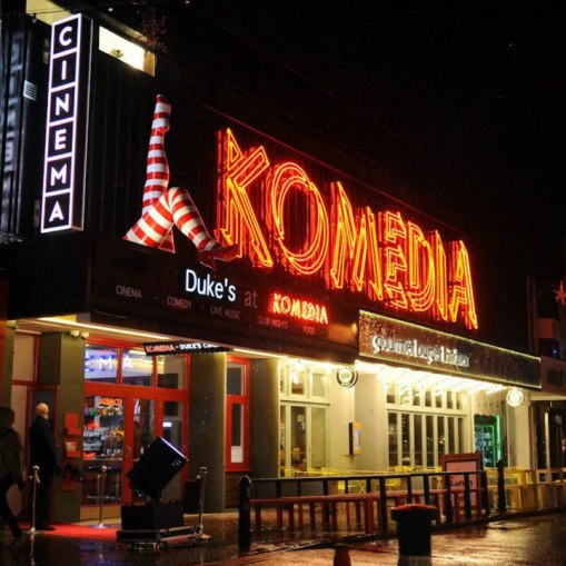 Komedia-outside-with-legs-l